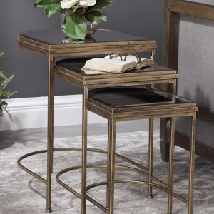 Nest of three antique gold tables